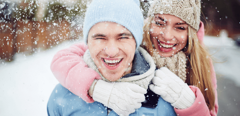 couple smiling snow