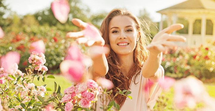 woman flowers field